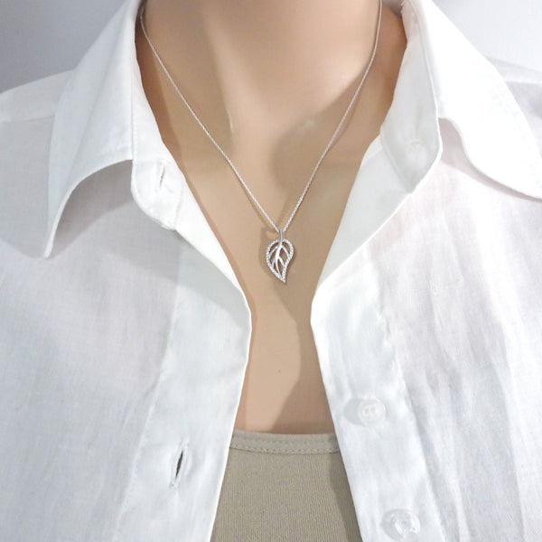 sterling silver leaf necklace on a model