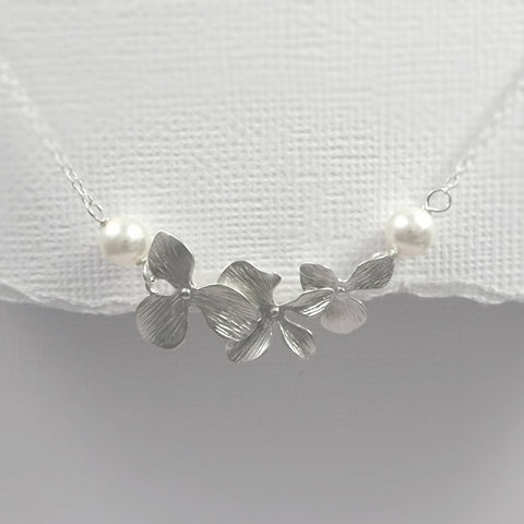 orchid and white pearl necklace