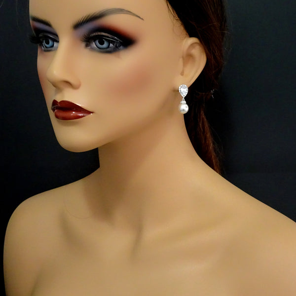 ivory pearl and cubic zirconia earrings on a model mannequin