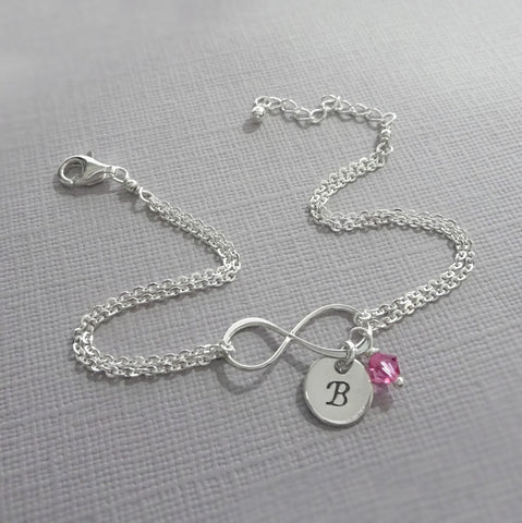 infinity chain bracelet with initial and birthstone charms