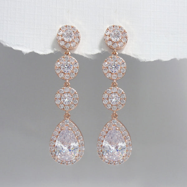 cubic zirconia pear crystal long dangle earrings in rose gold plated finish