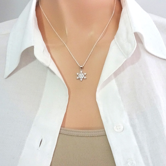 cubic zirconia snowflake necklace on a model mannequin