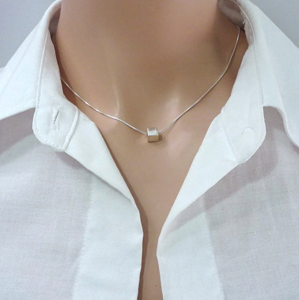 sterling silver cube necklace on a model mannequin