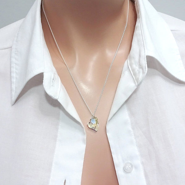crystal heart necklace on a model mannequin