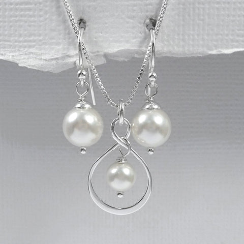 infinity and white pearl necklace and earrings set