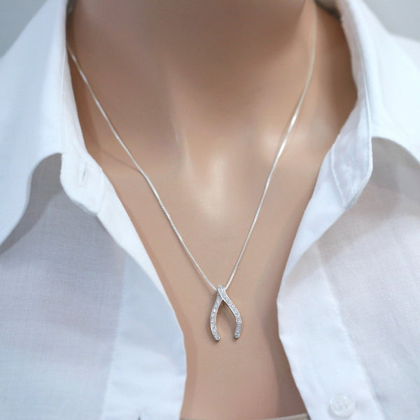 cubic zirconia wishbone necklace on a model mannequin