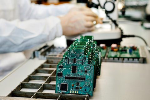 Microchip production factory. Technological process. Assembling the board. Chip. Professional. Technician. Computer expert. Manufacturing. Engineering