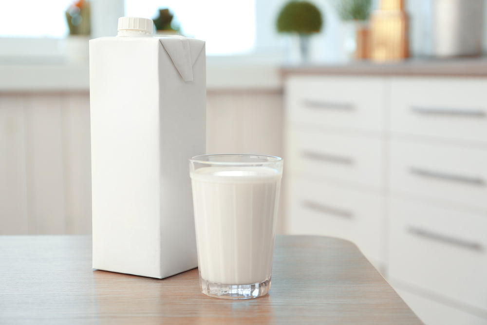 carton box glass milk on table