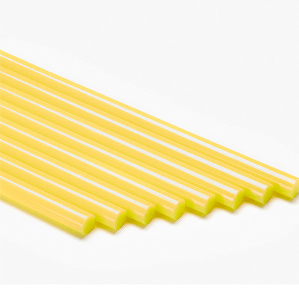 Yellow colored hot melt glue sticks by Infinity Bond