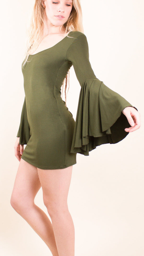 Girl wearing Umba's Bell Sleeve Tunic, Festive Long Sleeve Mini Dress, olive, side view, sold at UMBA LOVE