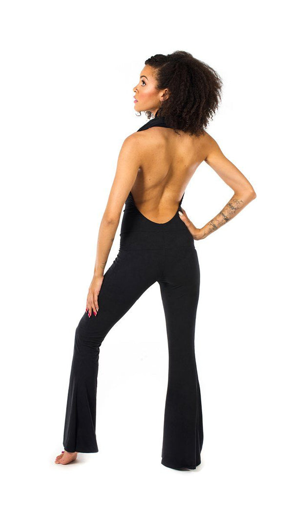 Girl wearing Warrior Within Black Bamboo Firebird Slim Bell Onesie features backless, halter cowl neck, black, back view, is sold at UMBA LOVE.