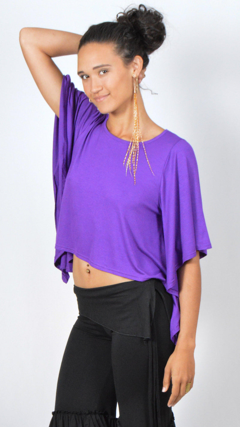 Girl wearing Umba's purple Butterfly Sleeve Top with black gypsy, ruffled pirate short pants, front side view, festival fun, sold at Umba Love in Boulder, CO