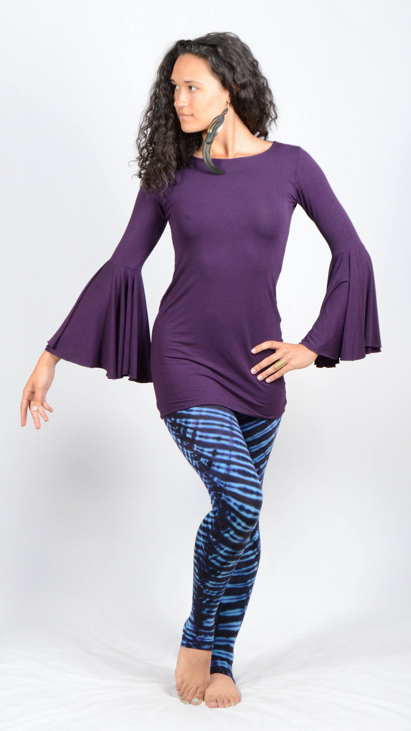 Girl wearing Umba's Bell Sleeve Tunic, Festive Long Sleeve Mini Dress, dark purple, with leggings, front view, sold at UMBA LOVE.