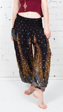 girl wearing black feather genie pants front view sold at umba hippie clothing