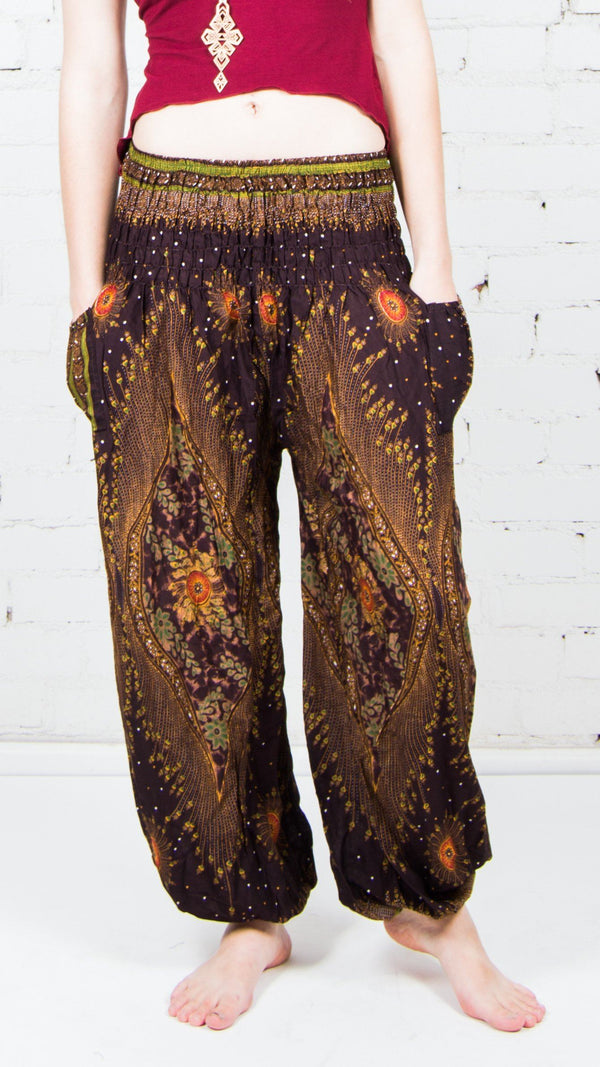 girl wearing brown feather genie pants front view sold at umba festival fashion