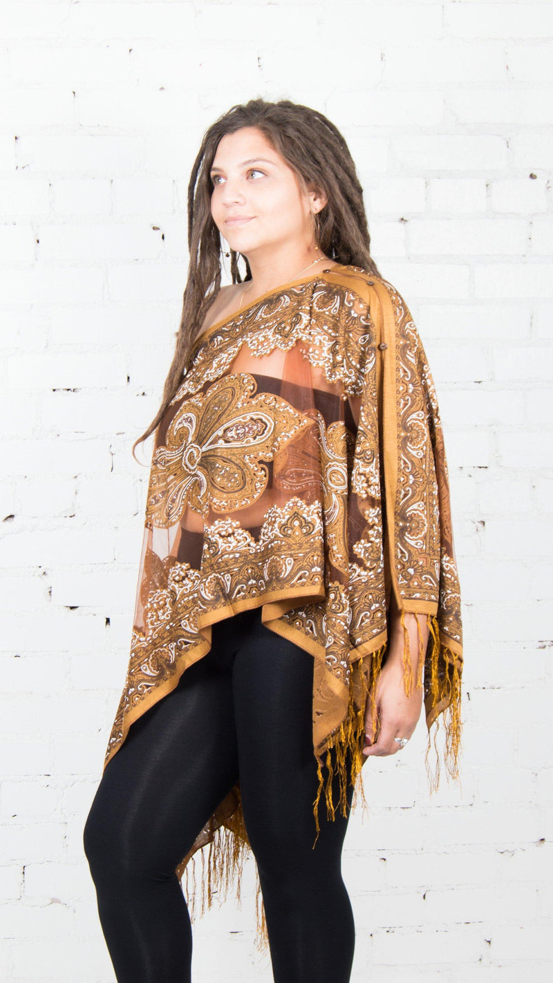 girl wearing chai gypsy poncho with fringe festival fashion