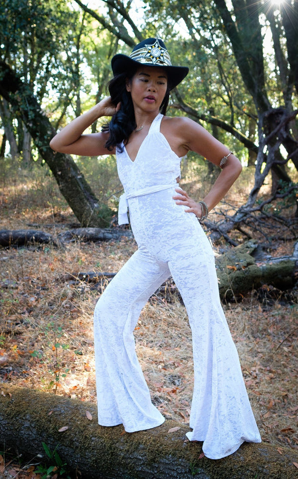 woman wearing white velvet tigra onesie warrior within umba love