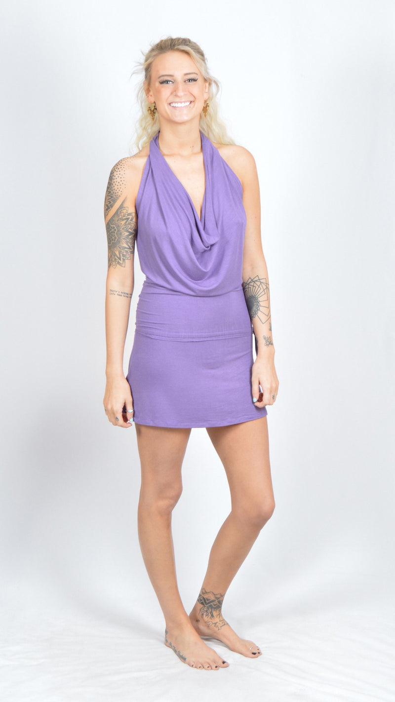 Girl wearing Umba Backless Cowl Neck Dress, cinched sides, lavender, front view, white brick background, sold at UMBA LOVE.