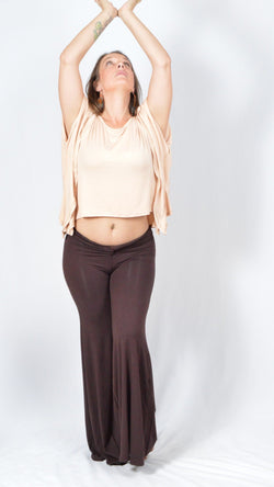 Girl wearing Umba's beige Butterfly Sleeve Top with brown knotted long pants, front view, festival fun, sold at Umba Love in Boulder, CO