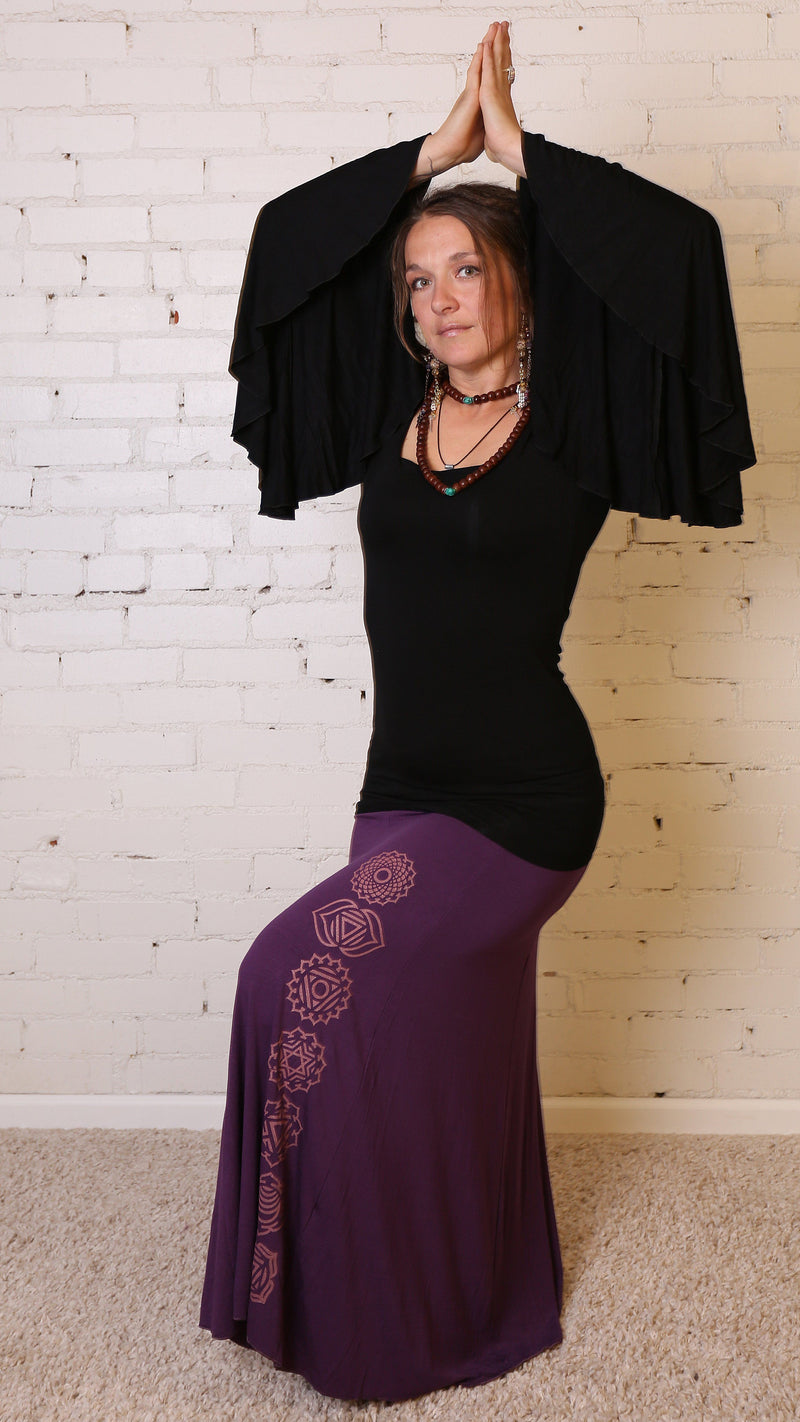Girl wearing Umba's Bell Sleeve Tunic, Festive Long Sleeve Mini Dress, black, with purple maxi skirt, front view, sold at UMBA LOVE.