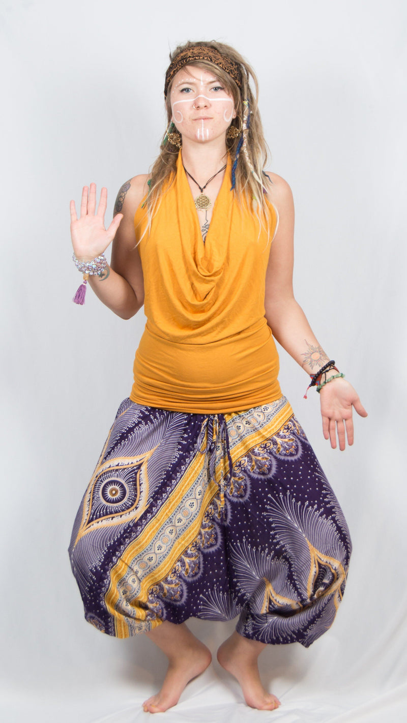 Girl wearing Umba Festival Fashions, navy feather harem pants and gold sleeveless cowl neck tank top, front view, sold at Umba Love.
