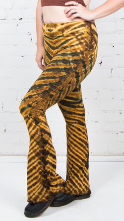 girl wearing yellow brown stripe tie dye bottoms umba love festival clothing
