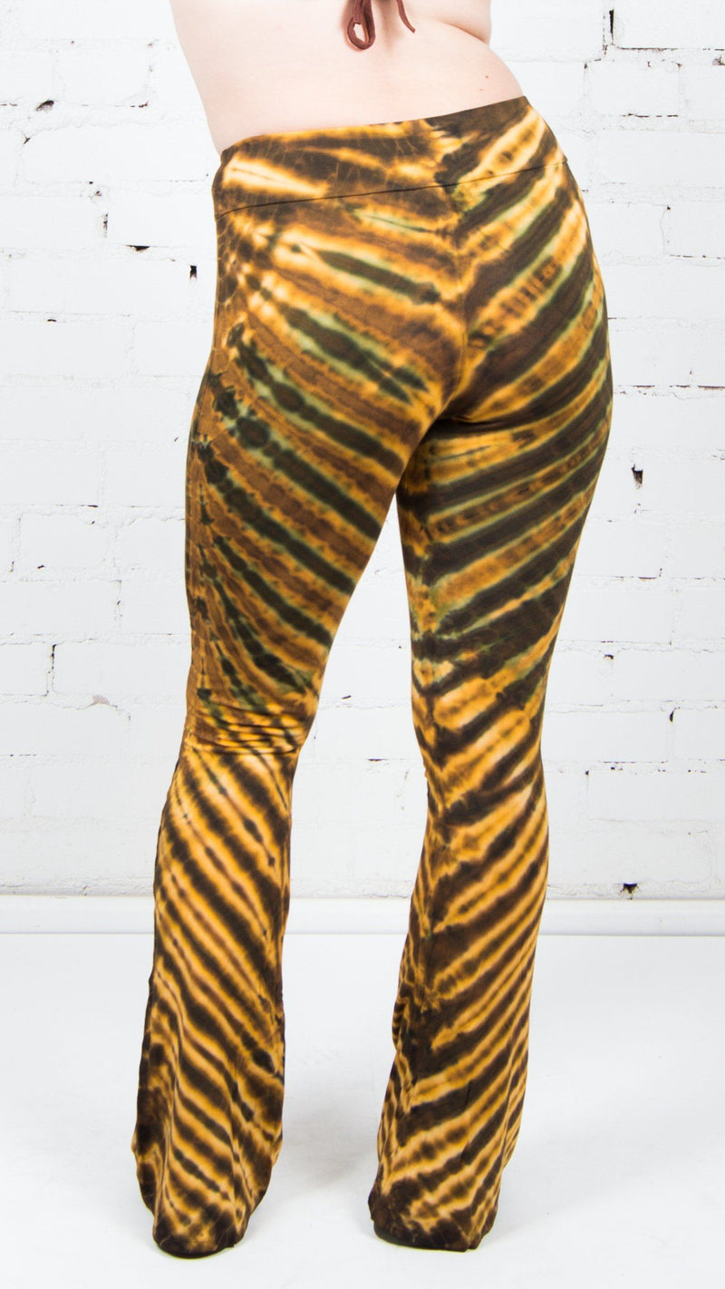 girl wearing yellow brown stripe tie dye bell bottoms umba love yoga pants