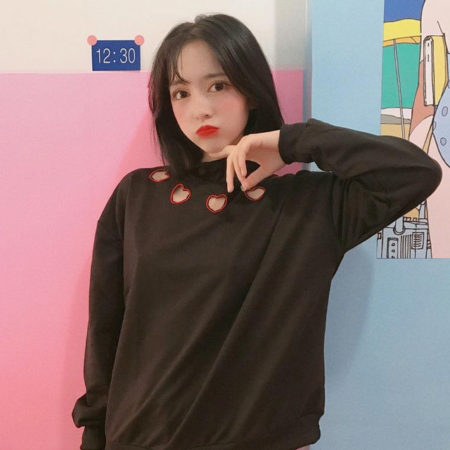 HEART CUT-OUT SWEATSHIRT