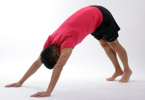 man doing downward dog pose