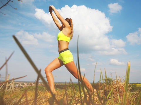 Woman doing exercises on an open field