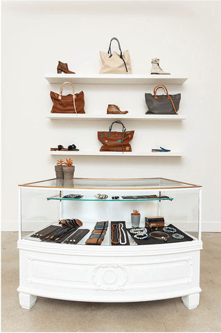 Esquivel House's vintage jewelry case features pieces from Will Hanigan Pearls and Cheryl Dufault. Leather accessories by Esquivel, like the LAX totes and made-to-order footwear, are also on display above.