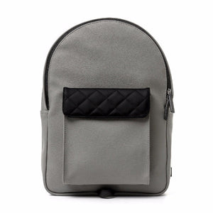 Strada Mini: Grey coated cotton material. Leather zipper, handle and logo patch. Diamond Shaped stitching. Lightweight. Water resistance.