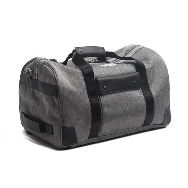 Venque Duffle bag grey. Black leather handle and exterior flaps. High grade quanta fabric