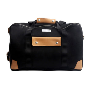 Venque Duffle bag black made with quanta fabric. Real leather handle and exterior flaps