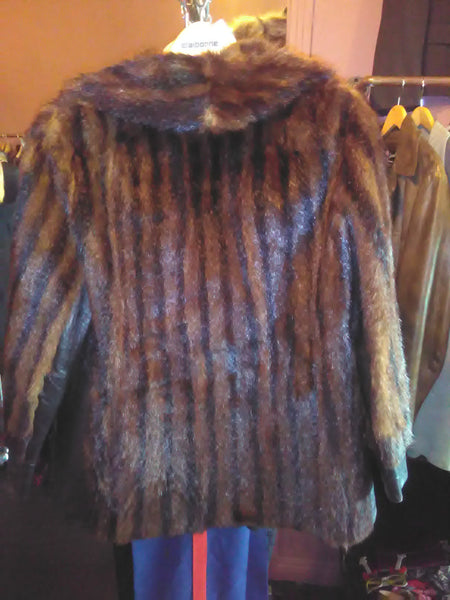 stripped fur and chocolate leather coat