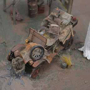 model car in model train scenery