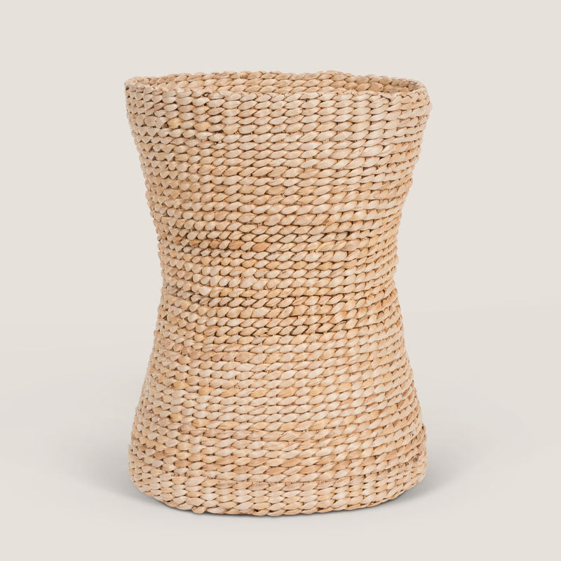 Neutral coloured hourglass basket made of banana leafs