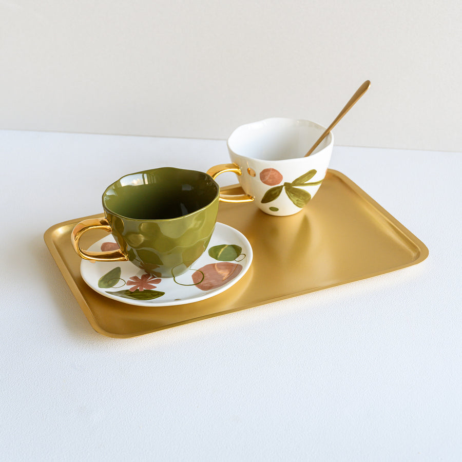 Picture of Golden serving tray with 2 good morning cups on top of it.