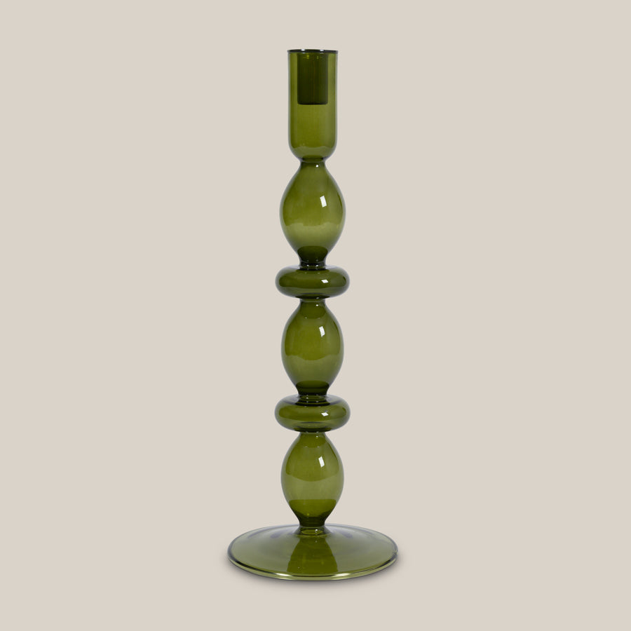 Green candle holder made of recycled glass.