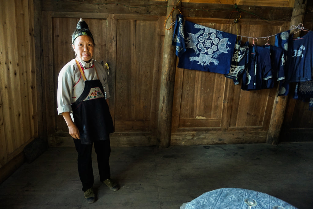 Miao woman artisan batik indigo Guizhou China handicraft