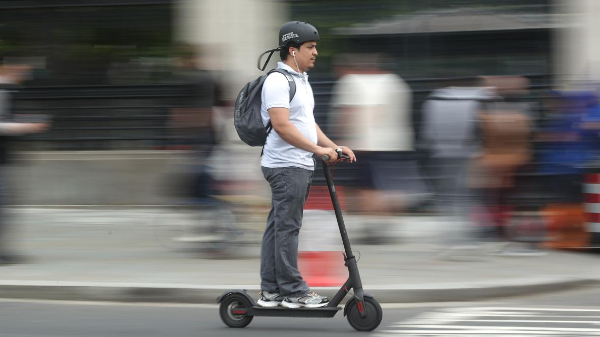 Electric scooter rider riding e scooter