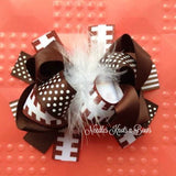 Girls football hair bow. If you choose this headband over the team shabby chic style headband, I will send out a crocheted headband to attach this to and she will be able to wear it for years as you can take it off the headband when she has enough hair.