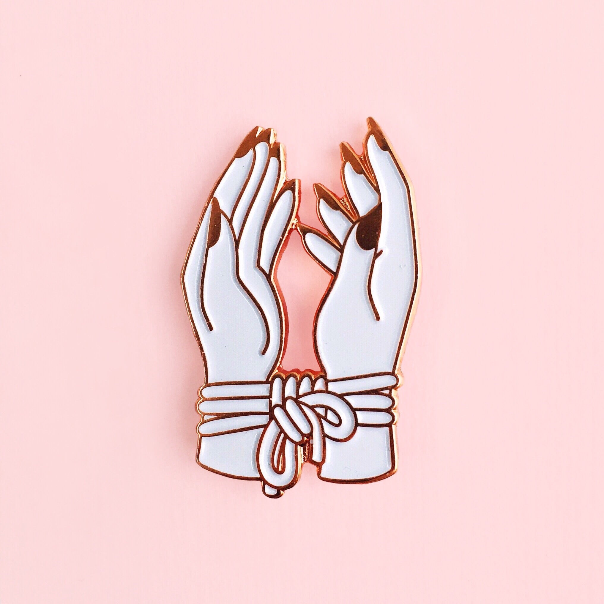 Bound hands pin