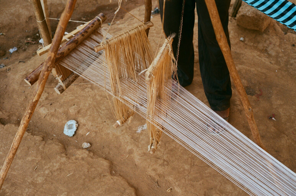 Tripod Loom Sierra Leone Carrying Colour