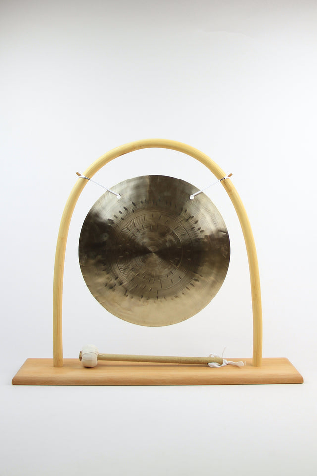 feng wind gong made from hammered bronze w/ rattan frame