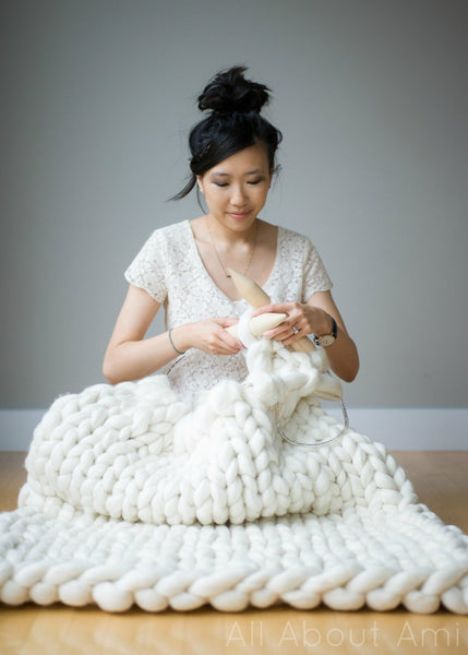 Woman crocheting with Mama Knows Luxury big merino yarn for extreme knit and crochet