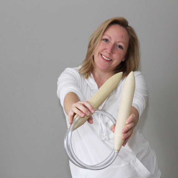Woman holding Mama Knows Luxury Handcrafted Circular Knitting Needles for extreme knitting. Needles made in Canada by M.D. Handfield Designs Inc.