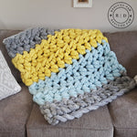 blanket made from Mama Knows Luxury Rescued Paw Designs Big Stitch Crochet Blanket Kit