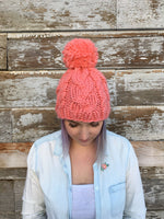 Woman wearing hat made from Mama Knows Luxury Pomtastic Hat Knitting Kit made in Canada