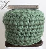 cushion made from Mama Knows Luxury Naturally Nora Extreme Finger Crochet Cushion Kit